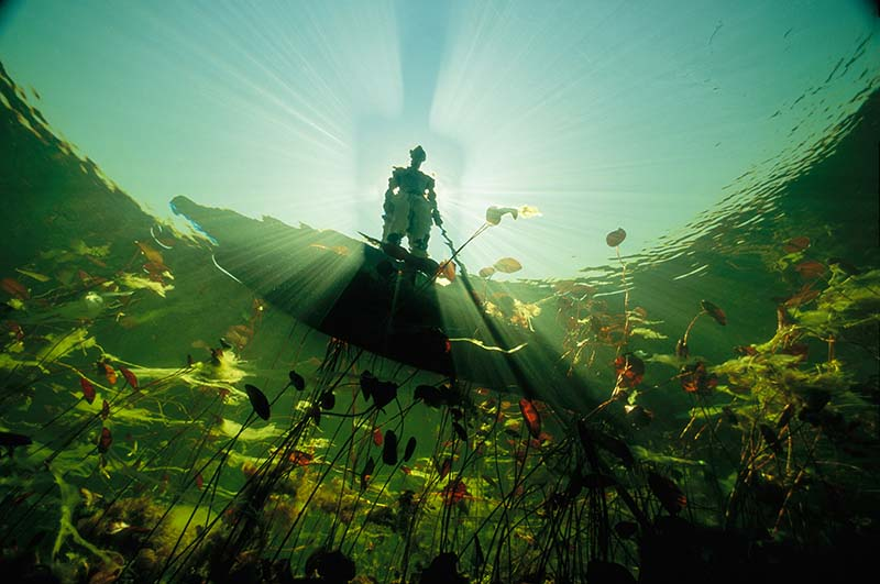 Fisherman in Mokoro Okavango Delta Botswana by David Doubilet