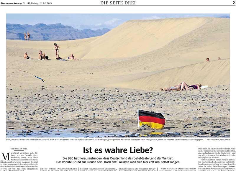 """Artikel in """"Süddeutsche Zeitung"""" vom 12.07.2013 mit Foto von Holger Rüdel"""
