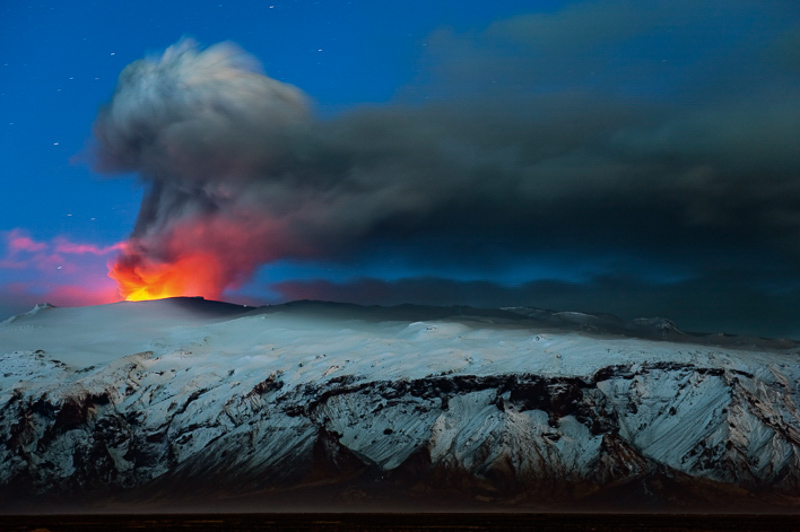 Ash plume and lava eruption from the Eyjafjallajökull volcano at night. Iceland, April 2010